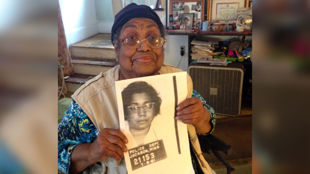 Lula White of New Haven holds the mug shot from her 1961 arrest.