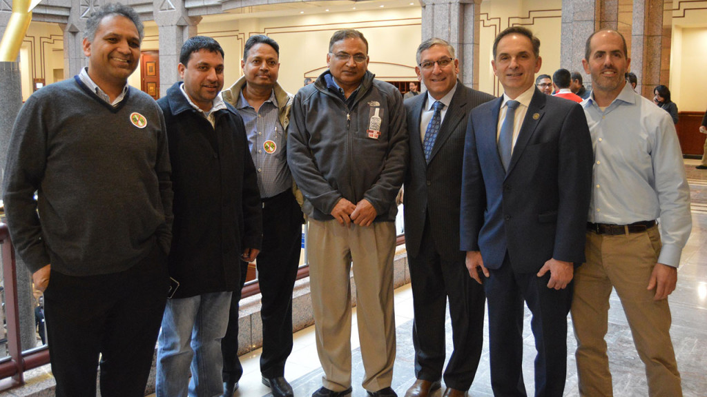 Sen. Fasano and Rep. Yaccarino meet a group of small package store owners from North Haven after testifying in opposition to the governor's proposal that would hurt small businesses.