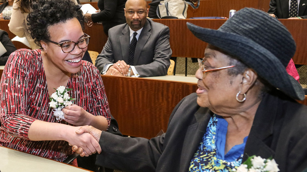 Quinnipiac University School of Law Alumna Stacy Renae Lynch, left, congratulates Lula White on Feb. 25. White, a former Freedom Rider during the civil rights movement, received the Quinnipiac University Black Law Students Association's Thurgood Marshall Award. Lynch, an alumna of the Quinnipiac School of Law, was the BLSA's Community Service Award recipient. (Chris Beauchamp for Quinnipiac University)