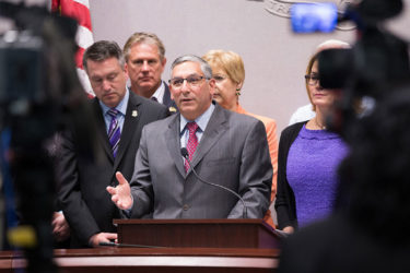 Sen. Fasano speaks at a press conference alongside fellow Republican lawmakers.