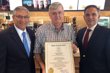 Sen. Fasano (left) and Rep. Yaccarino (right) present John McKnight (center) with a citation at his Washington Ave. McDonald's location in North Haven.